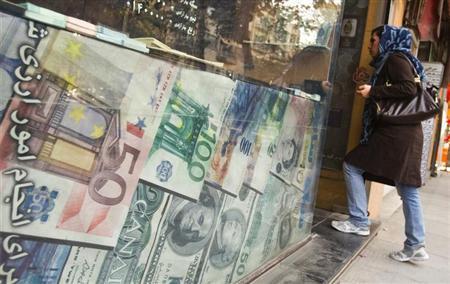 A woman enters a currency exchange shop in Tehran's business district October 24, 2011. REUTERS/Raheb Homavandi