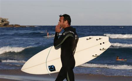 A surfer, wearing a Billabong wetsuit, leaves the water at Bondi beach in Sydney April 2, 2013. REUTERS/Daniel Munoz