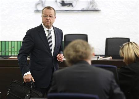 Holger Haerter, former CFO of German luxury carmaker Porsche Holding arrives for his trial at a Stuttgart courtroom September 5, 2012. Haerter goes to court on suspicion of a credit fraud. REUTERS/Alex Domanski