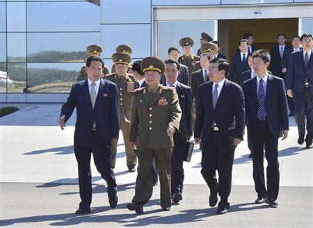 Choe Ryong-hae (C), director of the General Political Bureau of the Korean People's Army (KPA) of North Korea, walks with Chinese Ambassador Liu Hongcai (2nd R) before departing Pyongyang airport for China, in this May 22, 2013 picture released by the North Korea's KCNA news agency in Pyongyang. REUTERS/KCNA