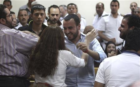 Friends of Egyptian suspects react after hearing the judge's verdict at a court room during a case against foreign non-governmental organisations (NGOs) in Cairo June 4, 2013. REUTERS-Asmaa Waguih