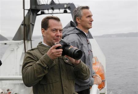 Russian Prime Minister Dmitry Medvedev (L) and his Norwegian counterpart Jens Stoltenberg are pictured on board the ''Helmer Hanssen'' research vessel just outside Kirkenes, in the extreme north-east of Norway, June 4, 2013. REUTERS/Cornelius