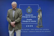 British naturalist David Attenborough poses for photographers after arriving in Oviedo, northern Spain, October 21, 2009. REUTERS/Eloy Alonso