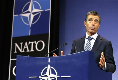 NATO Secretary General Anders Fogh Rasmussen holds a news conference during a NATO defence ministers meeting at the Alliance headquarters in Brussels June 4, 2013. REUTERS/Yves Herman