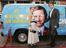 "Actor Will Ferrell and actress Christina Applegate pose next to a ""news van"" which they arrived in for the premiere of their new comedy film ""Anchorman The Legend of Ron Burgundy"" in Hollywood in this June 28, 2004, file photo. America's funniest fictional television news anchor Ron Burgundy from the 2004 comedy film ""Anchorman"" will be given the glass case treatment in a new exhibit on 1970s newsrooms, Washington D.C.'s Newseum said on June 4, 2013. REUTERS/Fred Prouser/Files"
