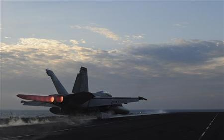 A F/A-18E Super Hornet fighter jet assigned to the Kestrels of Strike Fighter Squadron (VFA) 137 launches from the flight deck of the aircraft carrier USS Abraham Lincoln in this U.S. Navy handout photo dated February 13, 2012. REUTERS/U.S. Navy/Mass Communication Specialist 2nd Class Colby K. Neal/Handout