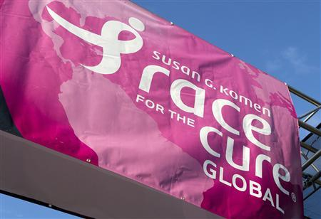 A sign for the Susan G. Komen Foundation's 2012 Race for the Cure is displayed in Washington June 2, 2012. REUTERS/Joshua Roberts