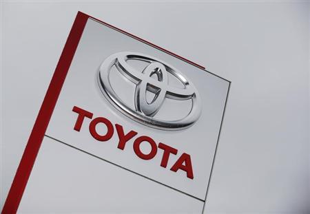 The Toyota logo is seen at a dealership in Ruemlang, outside Zurich October 10, 2012. REUTERS/Michael Buholzer