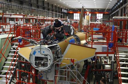 Engineers work at an Eurofighter Typhoon while setting up all component parts of an Eurofighter at the headquarters of Military Air Systems Centre Cassidian in Manching near Ingolstadt, southern Germany, February 28, 2013. REUTERS/Michaela Rehle