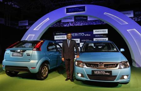 Pawan Goenka, President of Automotive and Farm Equipment Sectors at Mahindra & Mahindra, poses with the newly-unveiled Mahindra Verito Vibe compact car in Mumbai June 5, 2013. REUTERS/Vivek Prakash