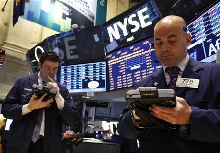 Traders work on the floor at the New York Stock Exchange, June 3, 2013. REUTERS/Brendan McDermid