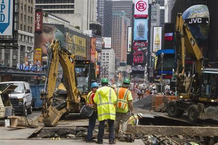 Workers stand near the site of a road construction, which closed off part of Times Square, in New York June 3, 2013. REUTERS/Zoran Milich