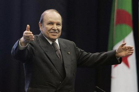 Algeria's President Abdelaziz Bouteflika waves during a speech to commemorate the 38th anniversary of the nationalisation of hydrocarbon resources in Oran February 24, 2009. REUTERS/Louafi Larbi