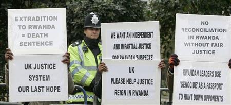 Protestors demonstrate outside the City of Westminster Magistrates Court in London during an extradition hearing of Rwandan immigrants Vincent Bajinya, Charles Munyaneza, Celestin Ugirashebuja and Emmanuel Nteziryayo January 26, 2007. REUTERS/Toby Melville