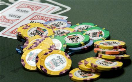 Chips and cards are shown on a poker table during the first day of the 41st annual World Series of Poker no-limit Texas Hold 'em main event in Las Vegas, Nevada in this file photo taken July 5, 2010. Ten years ago, poker shows proliferated on TV and then faded but with several states and federal legislators moving to legalize the game online, some networks are betting that TV poker is back. REUTERS/Steve Marcus/Files