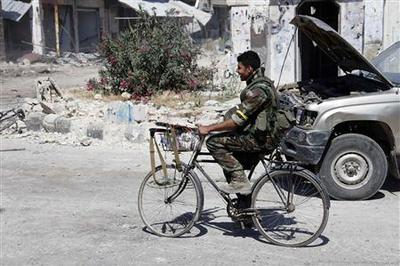 Syrian rebels lose strategic town in boost for Assad