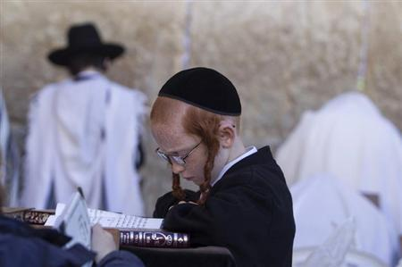 An ultra-Orthodox Jewish boy prays at the Western Wall, Judaism's holiest prayer site, during the Jewish holiday of Passover in Jerusalem's Old City March 28, 2013. REUTERS/Baz Ratne/Files
