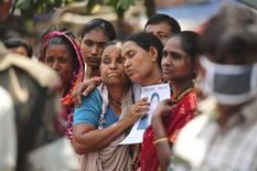 Relatives mourn as they look for a garment worker, who is missing after the collapse of the Rana Plaza building in Savar, outside Dhaka May 2, 2013. REUTERS/Khurshed Rinku