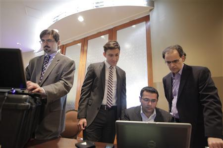 Microsoft staff and forensics experts examine evidence related to the Citadel malware that was collected from a New Jersey data center in Atlantic City, New Jersey in this June 5, 2013 handout photo provided by Microsoft. REUTERS/Microsoft/Handout via Reuters
