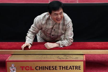Actor Jackie Chan poses during a hand and footprint ceremony at the TCL Chinese Theatre in Hollywood, California, June 6, 2013. REUTERS/Jonathan Alcorn