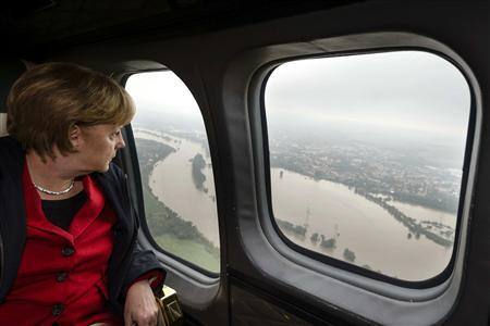 German Chancellor Angela Merkel looks down at flood damage from a helicopter during a flight between Dresden and Pirna June 4, 2013, in this picture provided by BPA. REUTERS/Steffen Kugler/BPA via Reuters