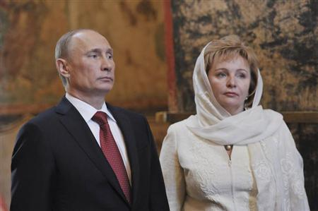 Vladimir Putin (L) and his wife Lyudmila attend a service, conducted by Patriarch of Moscow and All Russia Kirill, to mark the start of his term as Russia's new president at the Kremlin in Moscow, May 7, 2012. REUTERS/Aleksey Nikolskyi/RIA Novosti/Pool