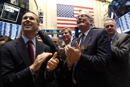 Patrick Allin (2nd R), Chairman and Chief Executive Officer of Textura Corporation, celebrates his company's IPO on the floor at the New York Stock Exchange, June 7, 2013. REUTERS/Brendan McDermid