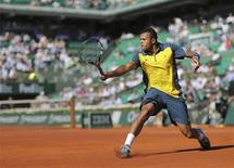 Jo-Wilfried Tsonga, qui a raté vendredi l'occasion d'être le premier Français en finale de Roland-Garros depuis vingt-cinq ans, a assuré vendredi après sa défaite cinglante contre David Ferrer n'avoir pas subi le poids de l'événement. /Photo prise le 7 juin 2013/REUTERS/Stéphane Mahé