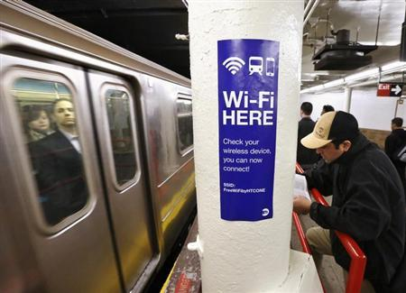 A sign advertises Wi-Fi service in the Times Square Subway station in New York, April 25, 2013. REUTERS/Brendan McDermid/Files