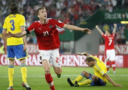 Austria's Marc Janko celebrates after scoring against Sweden during their 2014 World Cup qualifying soccer match at the Ernst Happel stadium in Vienna, June 7, 2013. REUTERS/Dominic Ebenbichler