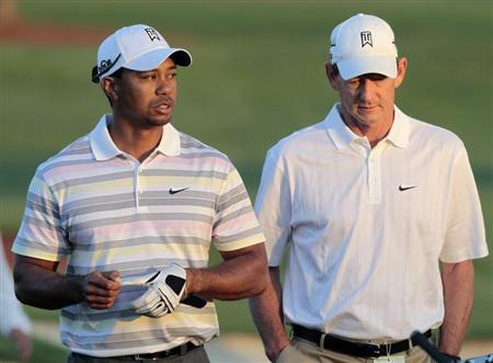Tiger Woods (L) of the U.S. walks off the driving range with his swing coach Hank Haney (R) before his practice round for the 2010 Masters golf tournament at the Augusta National Golf Club in Augusta, Georgia, April 5, 2010. REUTERS/Hans Deryk