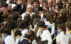 Pope Francis is surrounded by children during a special audience with students of Jesuit schools in Paul VI hall at the Vatican June 7, 2013. REUTERS/Max Rossi