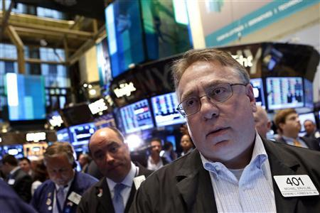 Traders work on the floor at the New York Stock Exchange, June 7, 2013. REUTERS/Brendan McDermid