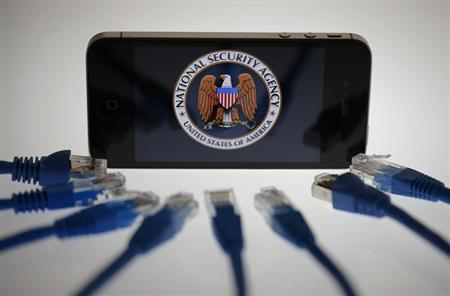 An illustration picture shows the logo of the U.S. National Security Agency on the display of an iPhone in Berlin, June 7, 2013. REUTERS-Pawel Kopczynski
