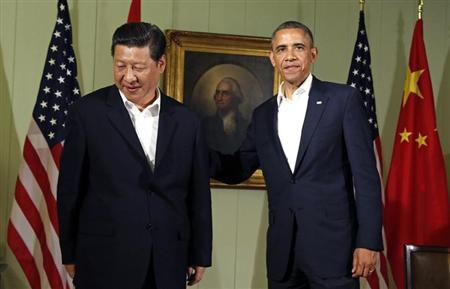 U.S. President Barack Obama puts his hand on the back of Chinese President Xi Jinping at The Annenberg Retreat at Sunnylands in Rancho Mirage, California June 7, 2013. REUTERS/Kevin Lamarque