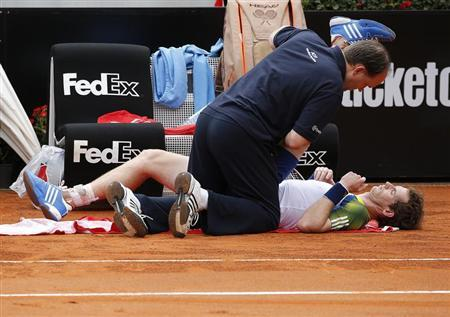 Andy Murray of Britain receives medical care during his match against Marcel Granollers of Spain at the Rome Masters tennis tournament May 15, 2013. REUTERS/Tony Gentile