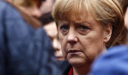 German Chancellor Angela Merkel visits the flood affected centre of Passau, about 200 km (124 miles) north-east of Munich June 4, 2013. REUTERS/Michaela Rehle