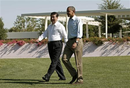 U.S. President Barack Obama and Chinese President Xi Jinping (L) walk the grounds at The Annenberg Retreat at Sunnylands in Rancho Mirage, California June 8, 2013. The two-day talks at a desert retreat near Palm Springs, California, was meant to be an opportunity for Obama and Xi to get to know each other, Chinese and U.S. officials have said, and to inject some warmth into often chilly relations while setting the stage for better cooperation. REUTERS/Kevin Lamarque