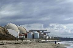 A man walks his dog next to the damaged San Onofre power plant located next to San Onofre State Park in California, in this November 8, 2012 file photo. REUTERS/Mike Blake