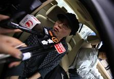 Liu Xia, wife of jailed Nobel Peace Prize Laureate Liu Xiaobo, talks to journalists after a trial outside a court in the Huairou district of Beijing June 9, 2013. REUTERS/Petar Kujundzic