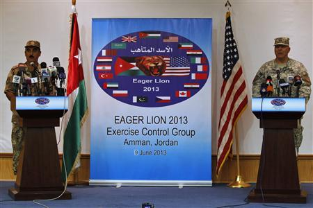 U.S. Army Maj. Gen. Robert Catalanotti (R), director, Exercises and Training Directorate J-7, U.S. Central Command, speaks during a news conference with Maj. Gen. Awni el-Edwan, Chief of staff of the Jordanian Operations and Training Armed Forces in Amman, June 9, 2013. REUTERS/Muhammad Hamed