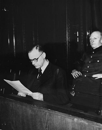 Defendant Alfred Rosenberg (L), the former Chief Nazi Party Ideologist, reads a document during the International Military Tribunal trial of war criminals at Nuremberg in 1946 in this photograph taken by the official U.S. Government photographer for the trials Charles W. Alexander of the Office of the United States Chief of Counsel and released to Reuters by the United States Holocaust Museum June 7, 2013. REUTERS/Charles W. Alexander/Office of the United States Chief of Counsel/United States Holocaust Museum courtesy of Robert Jackson/Handout