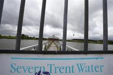 A Severn Trent sign hangs on a gate at Cropston Reservoir in Cropston, central England, May 15, 2013. REUTERS/Darren Staples
