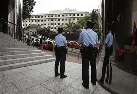 Policemen stand opposite the Consulate of the United States in Hong Kong June 10, 2013. REUTERS/Bobby Yip