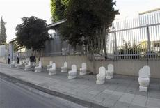 Mock toilets are placed outside the island's central bank in the capital Nicosia June 10, 2013. REUTERS/Andreas Manolis
