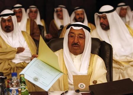 Kuwait's ruler Sheikh Sabah al-Ahmad al-Sabah reads during the opening of the two-day Arab Summit in Damascus March 29, 2008. REUTERS/Jamal Saidi