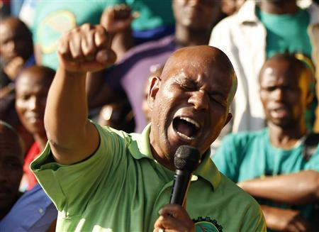 Joseph Mathunjwa, president of the Association of Mineworkers and Construction Union (AMCU), gestures as he addresses members of the mining community during a strike at Lonmin's Marikana platinum mine in Rustenburg, northwest of Johannesburg, May 15, 2013. REUTERS/Siphiwe Sibeko