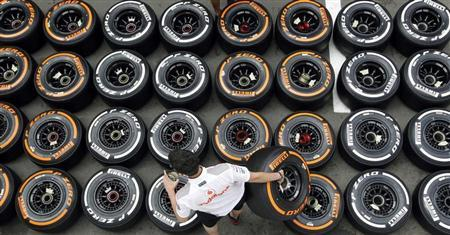 McLaren Formula One mechanic arranges Pirellis tyres in the paddock ahead of the Spanish Grand Prix at the Circuit de Catalunya in Montmelo, near Barcelona May 9, 2013. REUTERS/Albert Gea