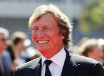 British television and film director and producer Nigel Lythgoe arrives at the 2012 Primetime Creative Arts Emmy Awards in Los Angeles September 15, 2012. REUTERS/Danny Moloshok