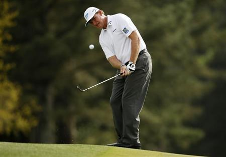 Ernie Els of South Africa chips to the 18th green during first round play in the 2013 Masters golf tournament at the Augusta National Golf Club in Augusta, Georgia, April 11, 2013. REUTERS/Mark Blinch